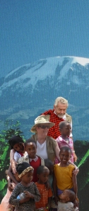 Bonnie and John in front of Mt. Kilimanjaro with children from the Maasia tribe in Tanzania.